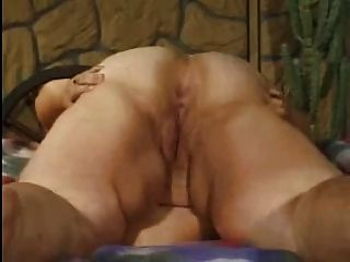 An interracial strip and blowjob play