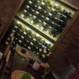 Ресторан Фаэтон - фотография 5 - Стеллаж для ценителей грузинских вин.