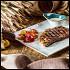 Ресторан Лен - фотография 8 - Обжаренный на раскаленной решетке рибай, в сопровождении помидорного салата и белого соуса барбекю.