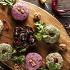 Ресторан Джонджоли - фотография 4 - Ассорти Пхали с рулетиками из обжаренных баклажанов.